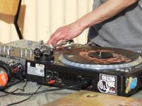 A DJ using a turntable
